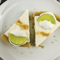 Featured image showing two slices of the finished easy no bake key lime pie.