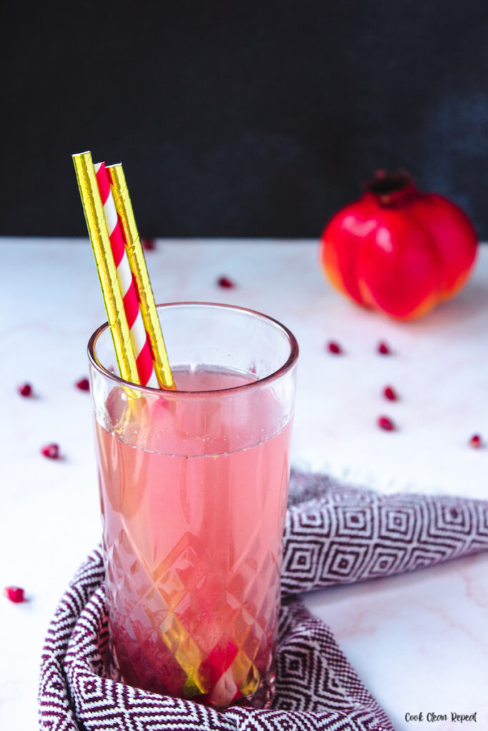a glass of the finished pink lemonade ready to drink.