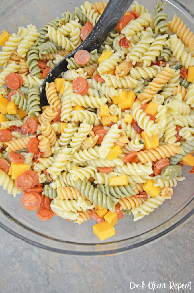 Italian pasta salad with pepperoni ready to be mixed and chilled.