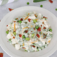 Featured image showing the finished pea salad with ranch dressing ready to eat.