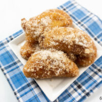 Featured image showing the finished fried apples recipe ready to eat on a plate, cinnamon sugar dusted on top of the fried apples.