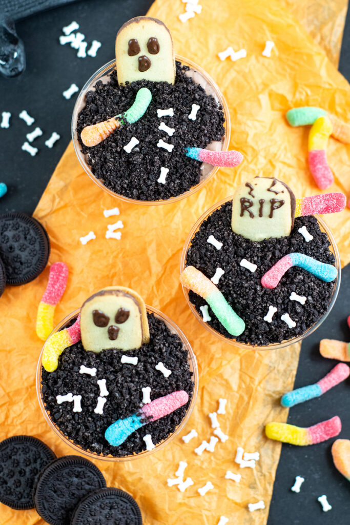 A top down look at a bunch of the finished halloween dirt pudding cups ready to eat.