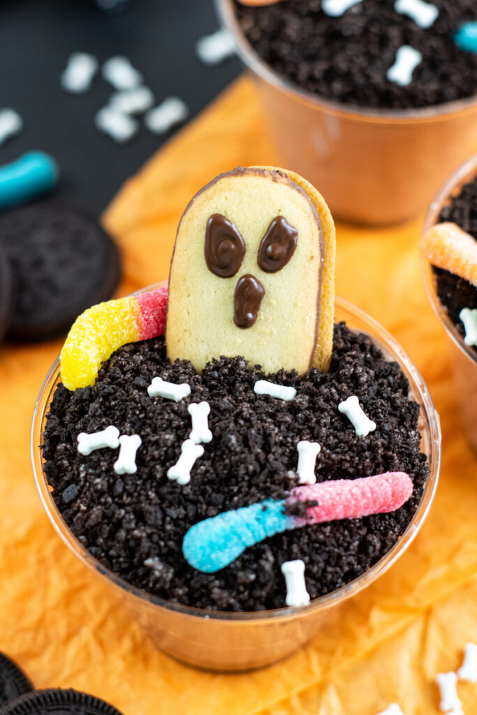 A finished look at the halloween dirt pudding dessert cups ready to eat.