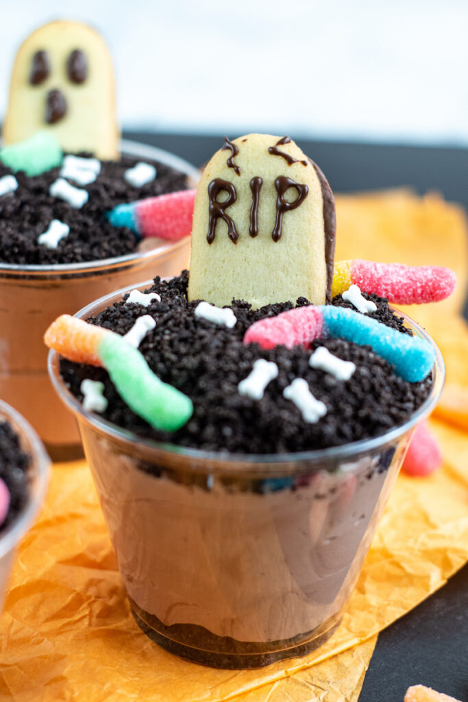 Close up of the finished halloween dirt pudding dessert cups ready to serve.