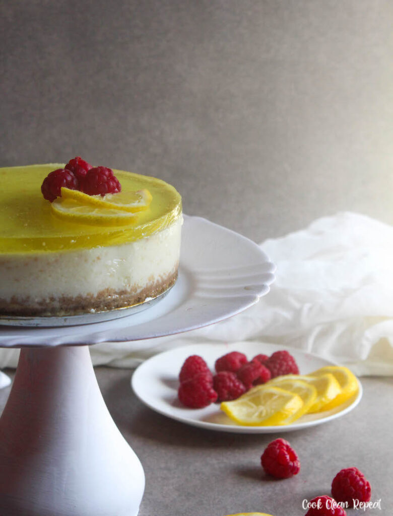 A close up side view of the finished lemon cheesecake ready to slice and eat.