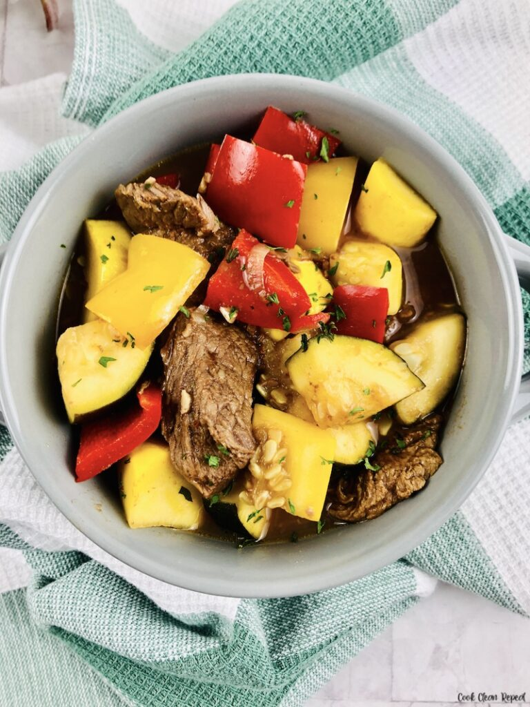 A top down look at a bowl full of the finished slow cooker summer squash stew.