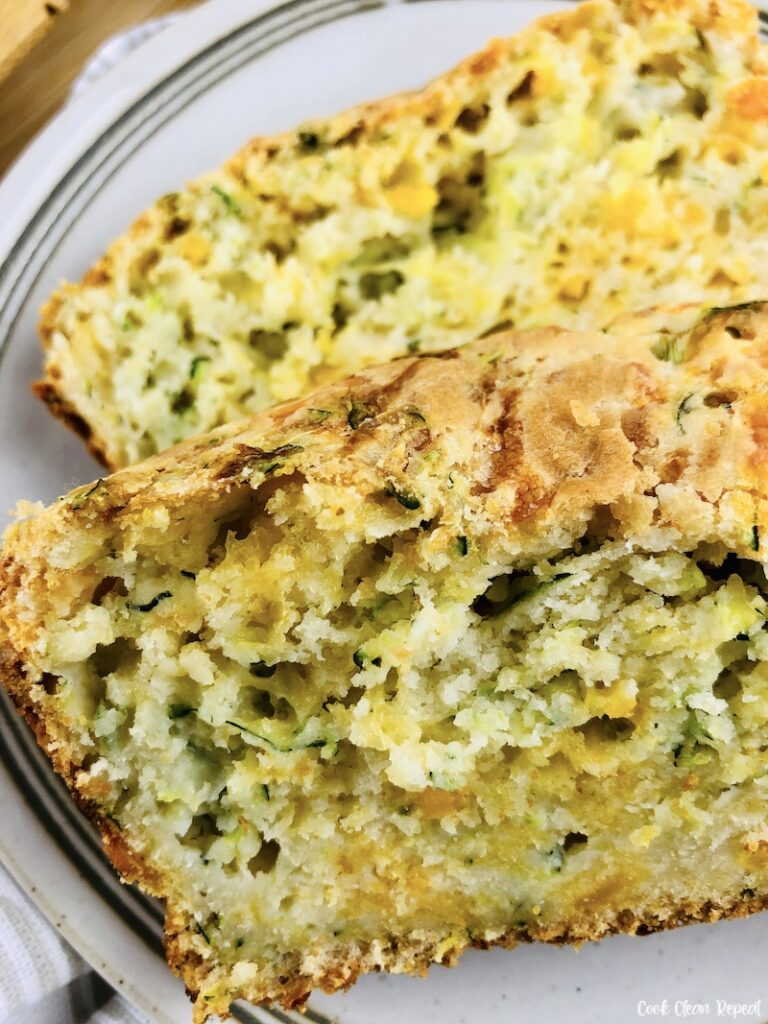 A close up look at some slices of they finished zucchini bread with cheese.