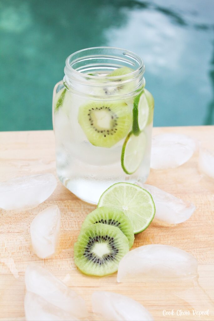 glass with ice and fruit slices around it ready to be enjoyed.