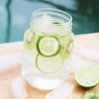 Featured image showing a glass of the finished kiwi lime water recipe ready to drink.