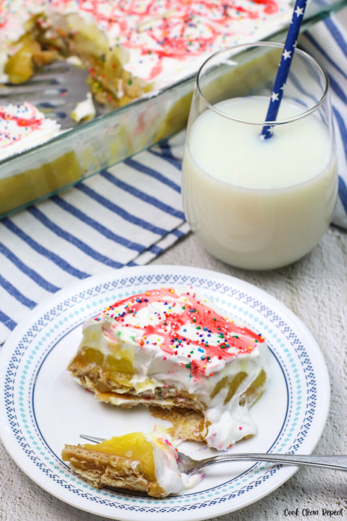 a slice of cake with a glass of milk.