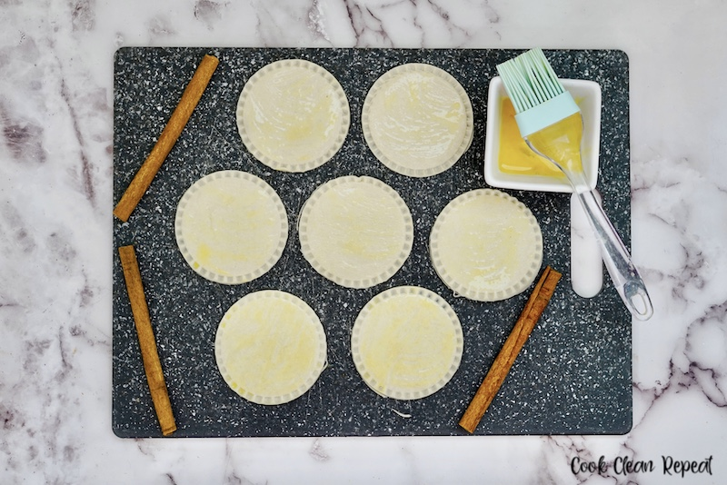 edges pressed the pies egg washed ready to go into the air fryer basket.