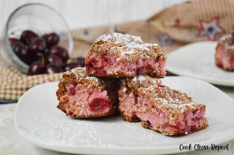 A plate with a stack of cherry bars ready to eat.