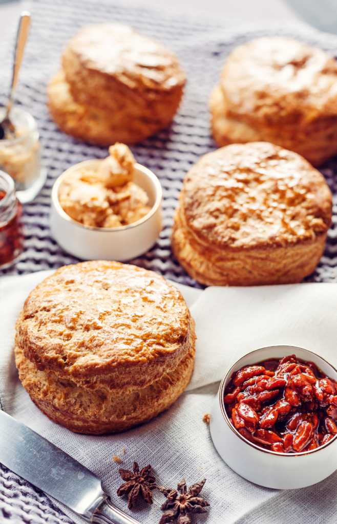 scones on a baking mat served with jelly and butter