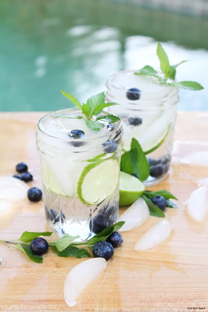 a few glasses of finished recipe for blueberry lime mint infused water.