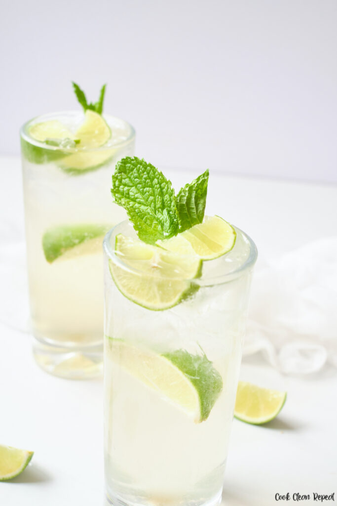 Two glasses of finished mint lime sparkling water ready to be enjoyed.